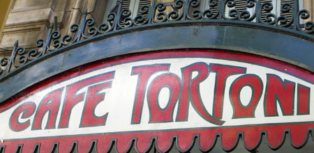 Gran Cafe Tortoni sign outside the door